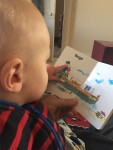 A Toddler Reading Richard Scarry's Boats